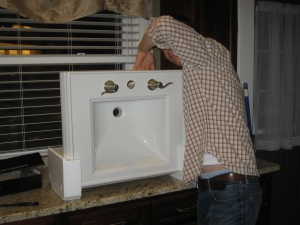 Jim attaching the faucets