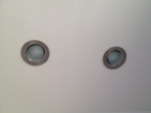 Close-up of recessed light covers