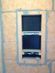 Tile cut for the inside of the shelves are resting inside