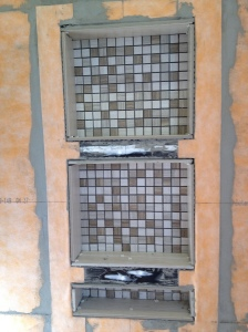 Mosaic tile for the back of the shelves in place!