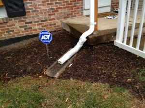 The downspout with an extender before