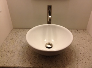 Close-up of vessel sink and facuet
