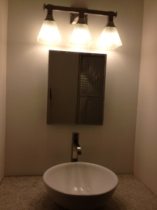 The sink with medicine cabinet and lights!
