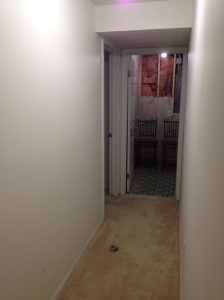 The hallway leading towards the laundry room