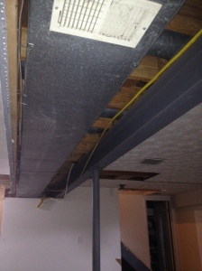 The ducts and beam are near each other in the ceiling