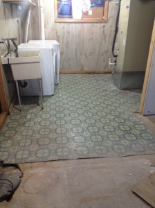 The laundry room with its wonderful linoleum floor and wood panels (the wall separating the laundry room from the main room is now gone).