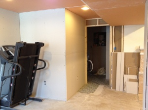 The laundry room closed off by drywall